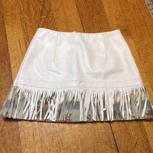 White leather skirt fringe western background